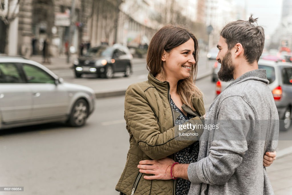 Happy loving couple in love on the street : Stock Photo