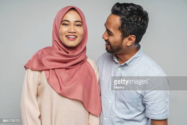 happy malaysian couple studio portrait - muslim couple stock pictures, royalty-free photos & images