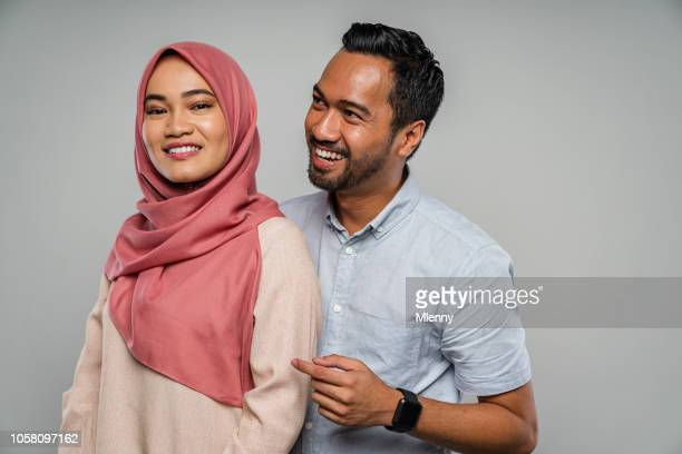 happy malaysian couple together portrait - muslim couple stock pictures, royalty-free photos & images