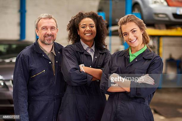 happy male auto mechanic team
