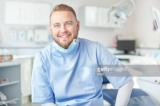 happy  male dentist portrait