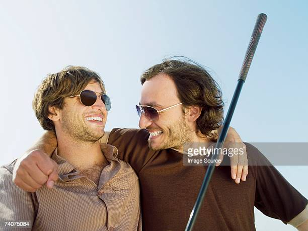 Happy male golfers