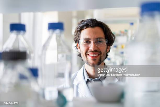 happy male scientist wearing protective eyewear - safety glasses stock pictures, royalty-free photos & images