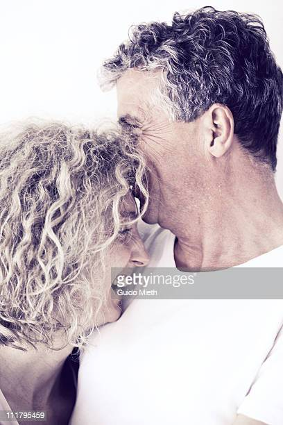 Happy man and his wife laughing together
