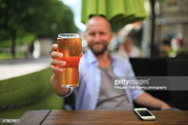 Happy man around 35 years old is drinking beer in a restaurant in Sundsvall, Sweden
