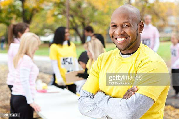 Happy man at a charity race, with copy space