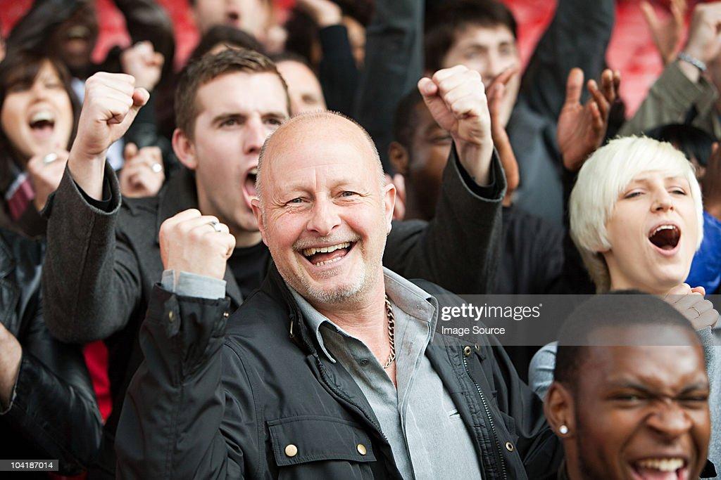Happy man at football match : Stock Photo