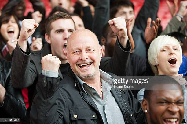 Happy man at football match