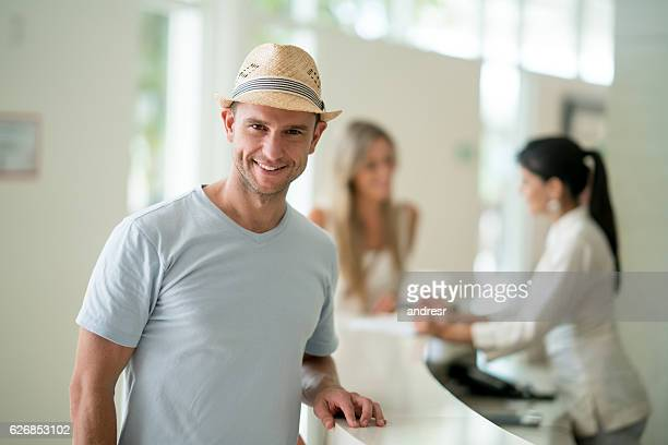 Happy man at the hotel