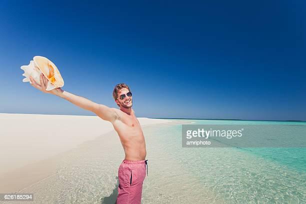 happy man beach sea shell summer holiday