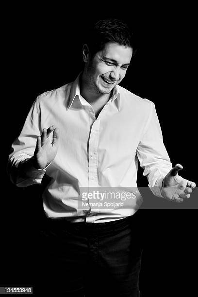 Happy man clapping hand