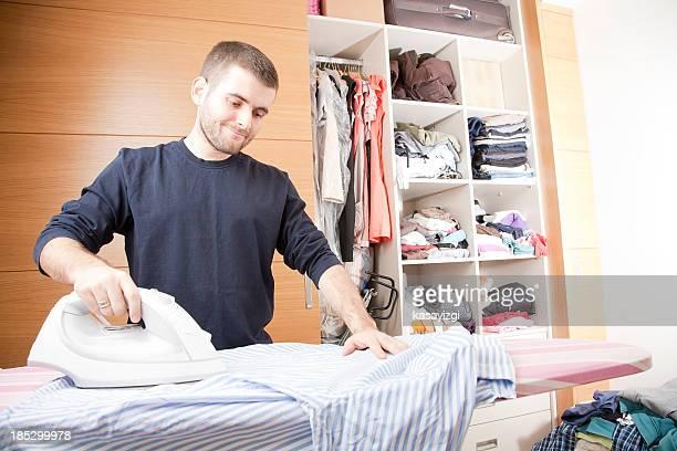 Happy Man doing ironing