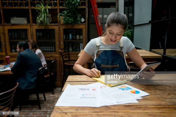 happy man doing the books at a restaurant - business plan stock pictures, royalty-free photos & images