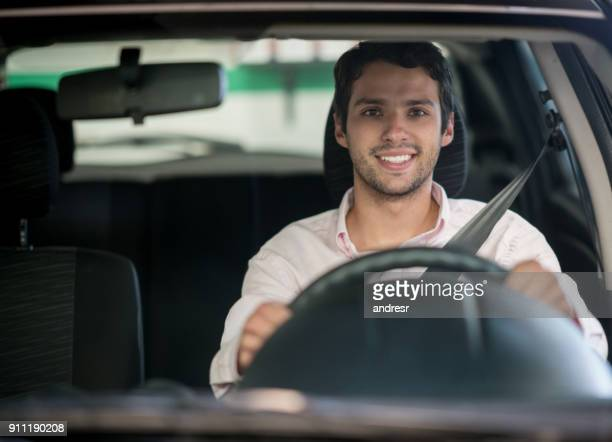 happy man driving a car at the garage - driver stock pictures, royalty-free photos & images