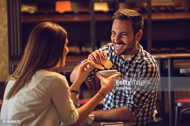 happy man enjoying in afternoon tea with his girlfriend. - dipping stock photos and pictures