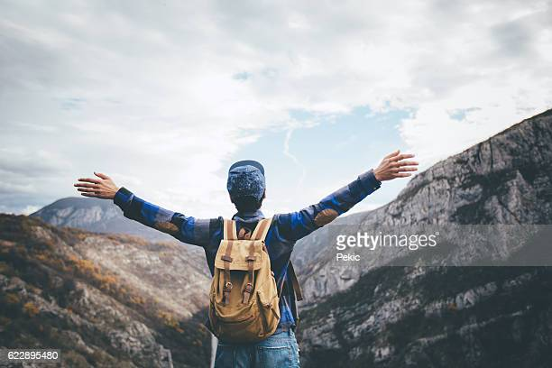 Happy man gesture triumph with hands in air