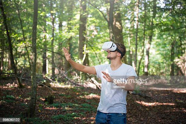 Happy man getting experience using VR-headset glasses