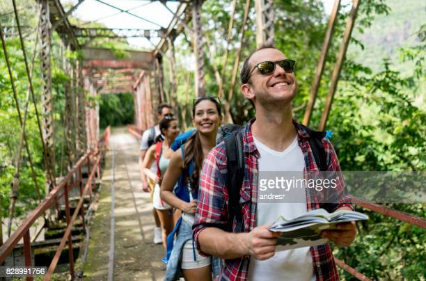 happy man hiking with a group - south america stock pictures, royalty-free photos & images