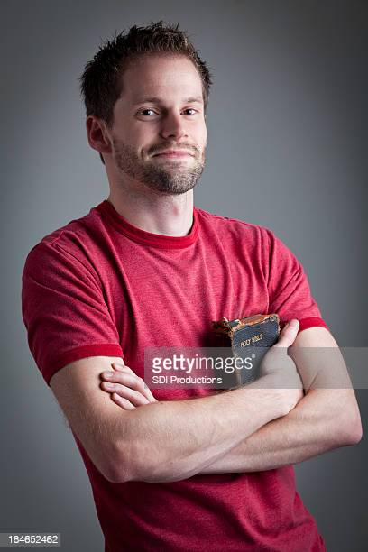 happy man holding his old used bible - smiling jesus stock pictures, royalty-free photos & images
