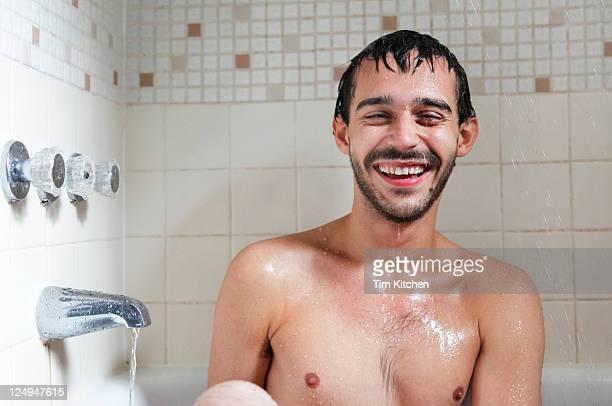 Happy man in bathtub, smiling