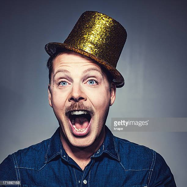 happy man in golden party hat - novelty item stock pictures, royalty-free photos & images