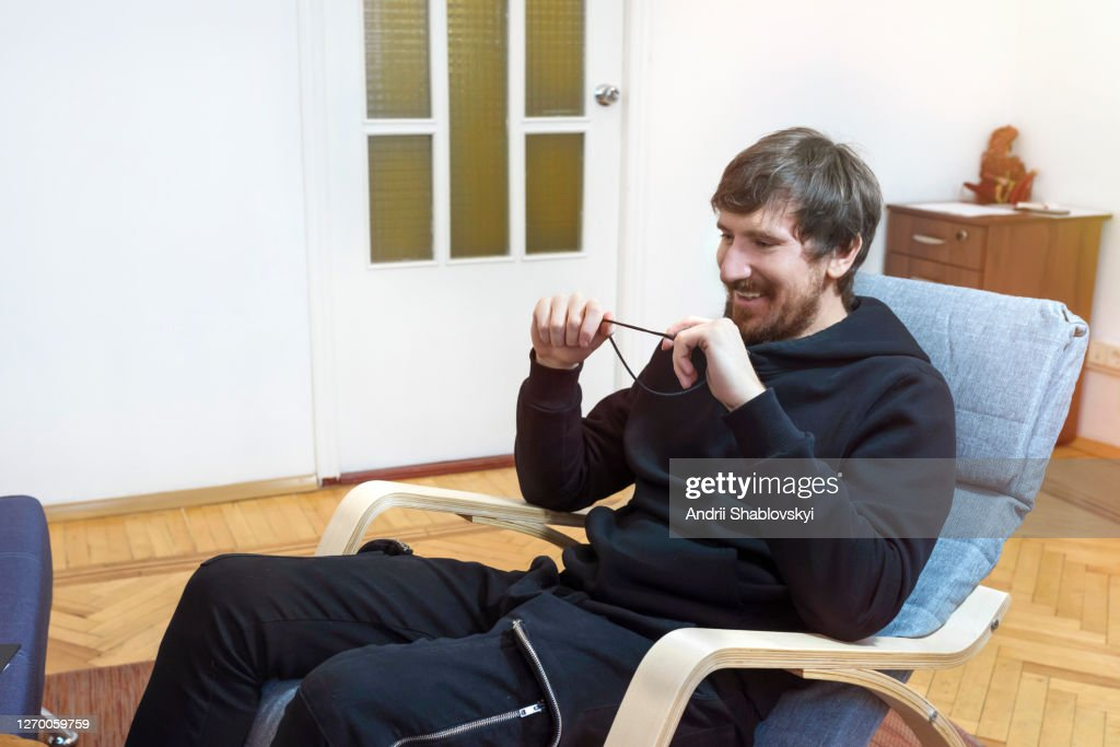 Happy man in the office of a psychologist. Patient at the reception of a psychotherapist. : Stock Photo