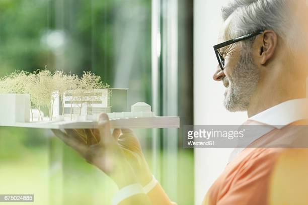 happy man looking at architectural model - architectural model stock pictures, royalty-free photos & images