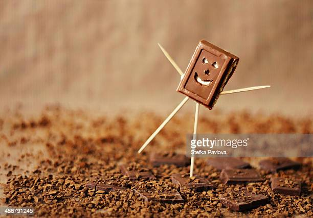 happy man made of chocolate bar and sticks