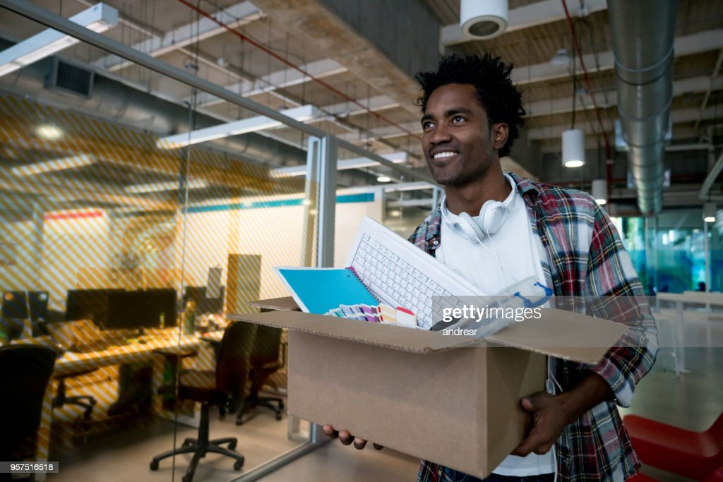 Happy man moving into a new office : Stock Photo