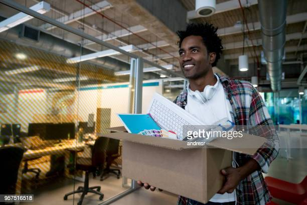happy man moving into a new office - being fired stock pictures, royalty-free photos & images