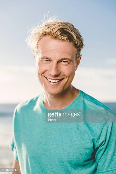 Happy man on beach
