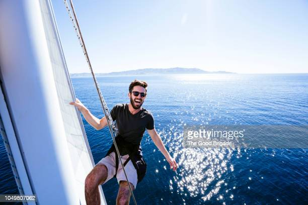 happy man on sailboat - sailing stock pictures, royalty-free photos & images