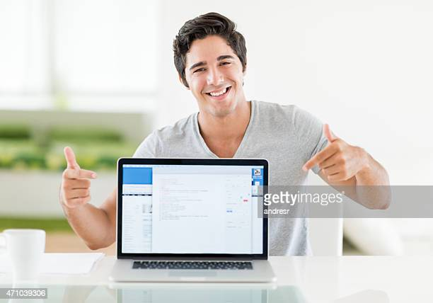 Happy man online on a laptop