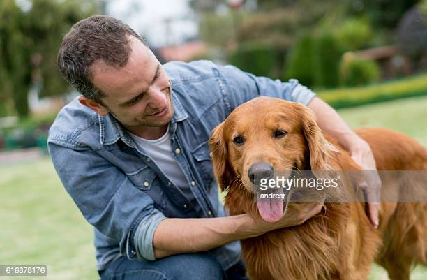 Happy man outdoors with his dog