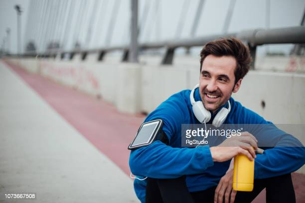 happy man resting after a run - mental wellbeing stock pictures, royalty-free photos & images