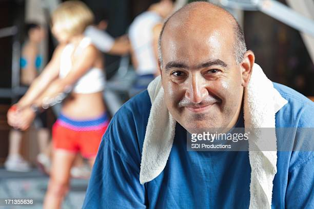 Happy man resting at his fitness club