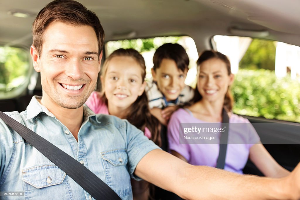 Happy Man Sitting With Family In Car : Stock Photo