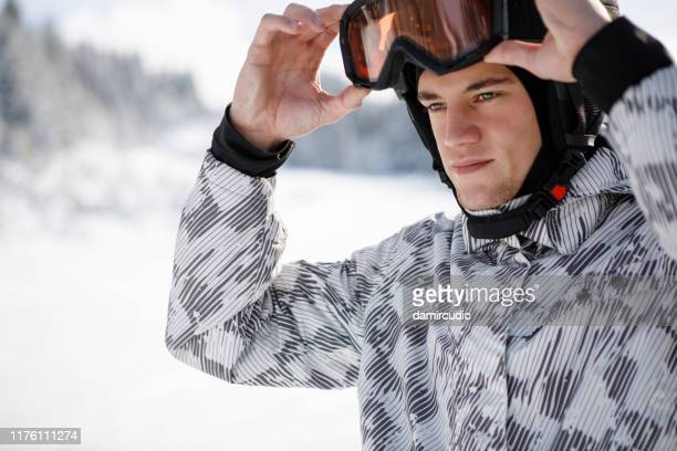 happy man skiing - damircudic stock photos and pictures