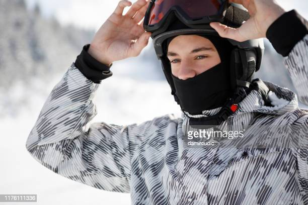 happy man skiing - eye protection stock pictures, royalty-free photos & images
