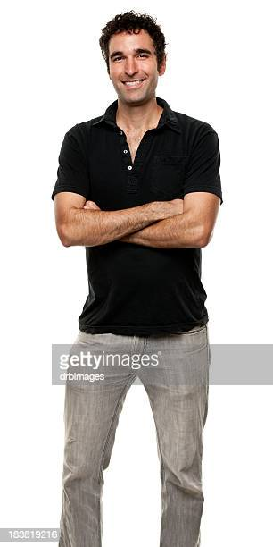 happy man standing with arms crossed - polo shirt stock pictures, royalty-free photos & images