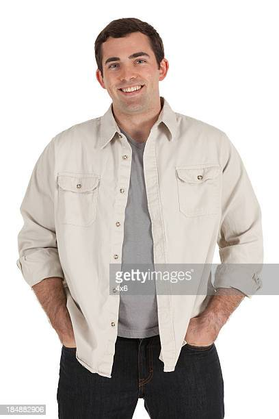 happy man standing with hands in pockets - driekwartlengte stockfoto's en -beelden