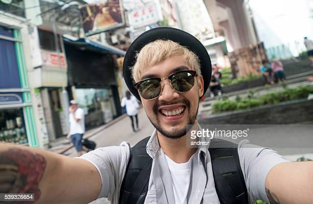 Happy man taking a selfie