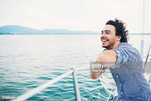 Happy man traveling on a yach
