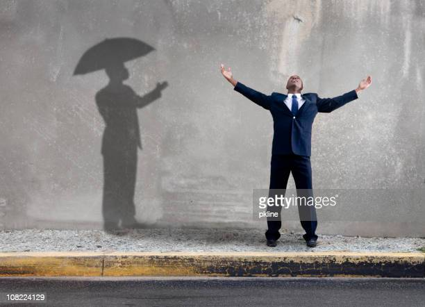 Happy Man with a Shadow Holding Umbrella