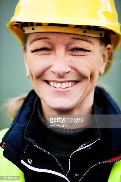 Happy Manual Female Worker In Yellow Hardhat