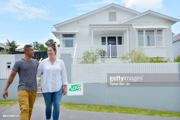 Happy Maori couple bought their new home