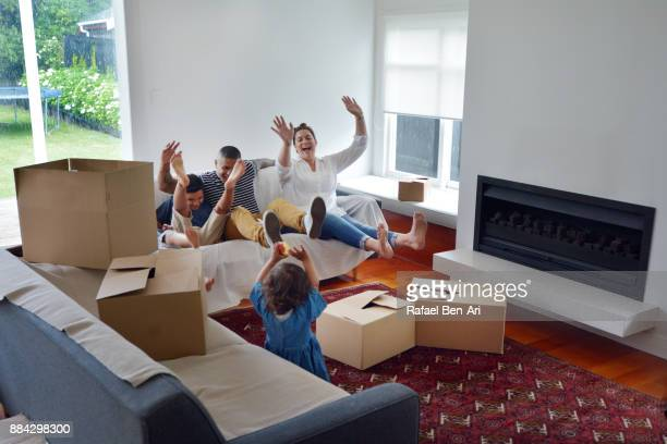 Happy Maori family relaxing in their new home