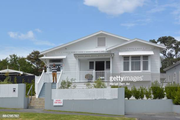 Happy Maori man sells his traditional bungalow house