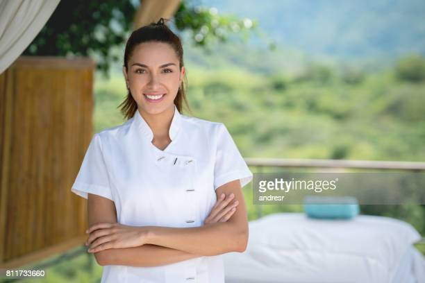 happy masseuse working at an outdoor spa - massage therapist stock pictures, royalty-free photos & images