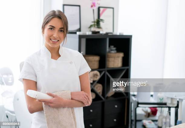 Happy masseuse working at the spa